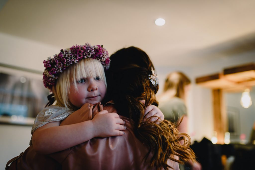 flower girl giving hugs