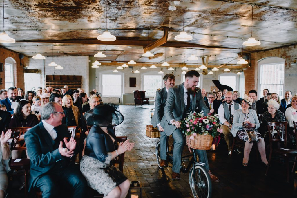 tandem bike riding through ceremony