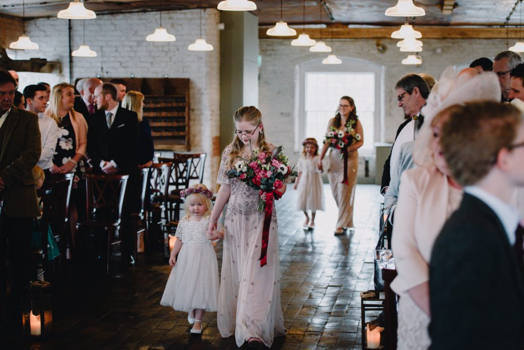 bridesmaids and flower girls in the ceremony