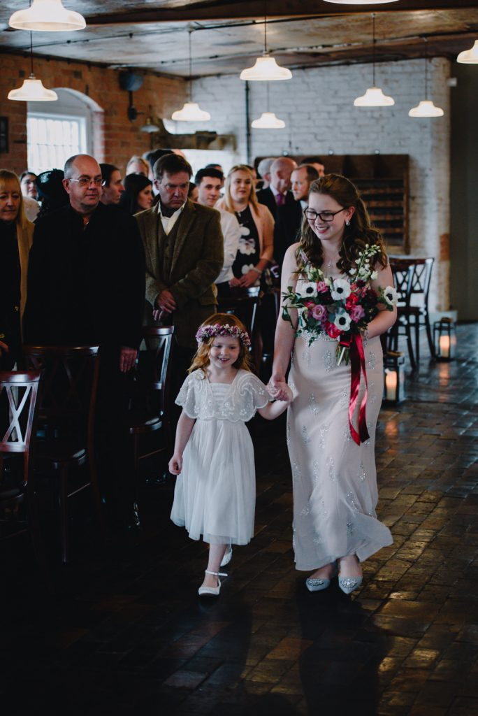 young flower girl and bridesmaid