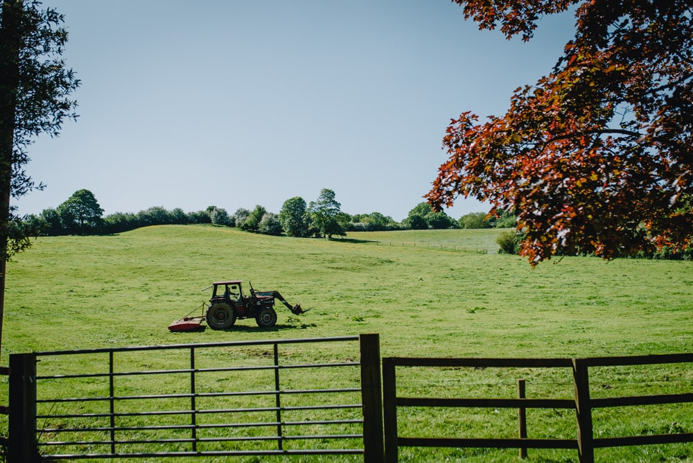 Farmer mowing the fields at Wood Farm Everdon