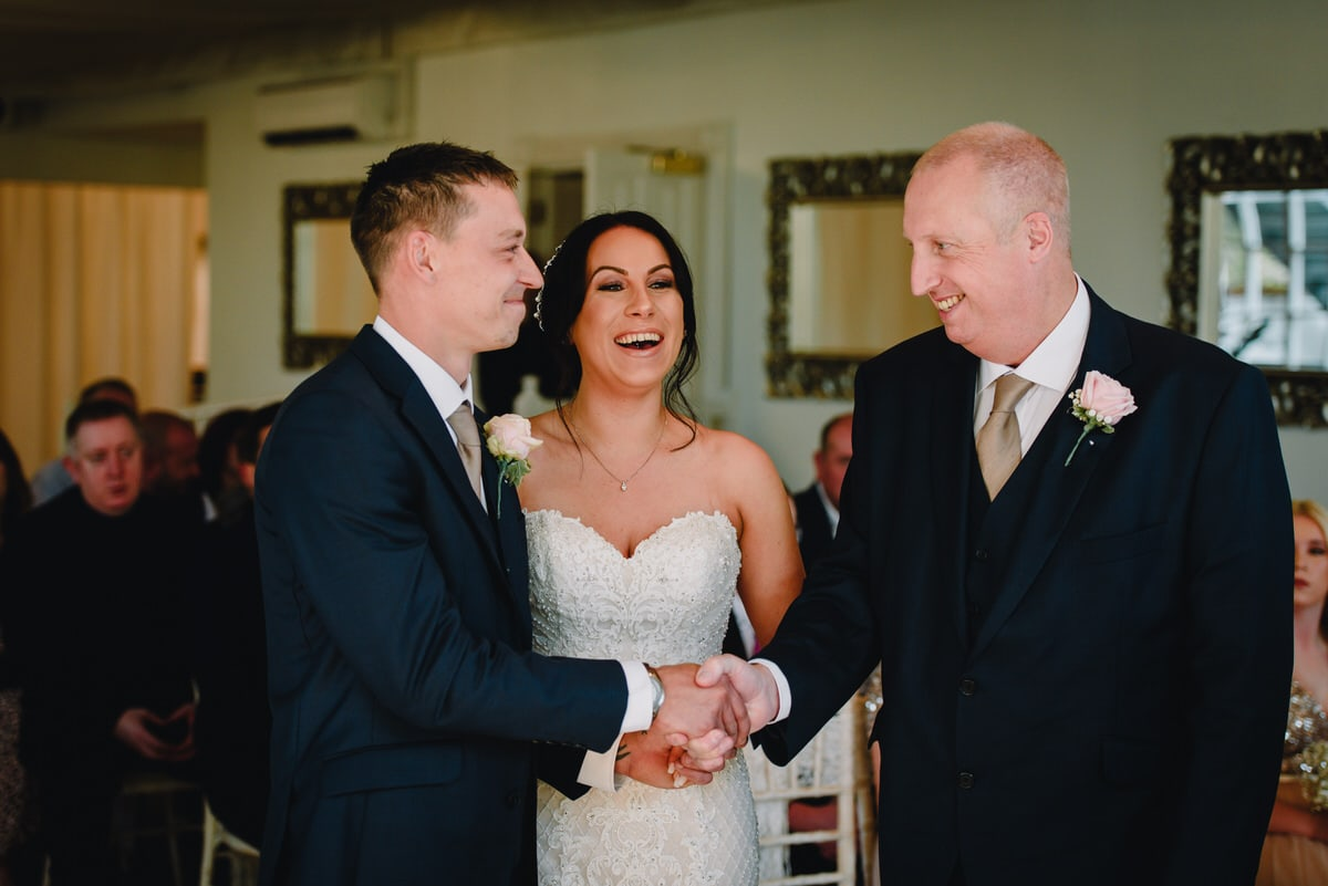 Father of the bride shakes grooms hand