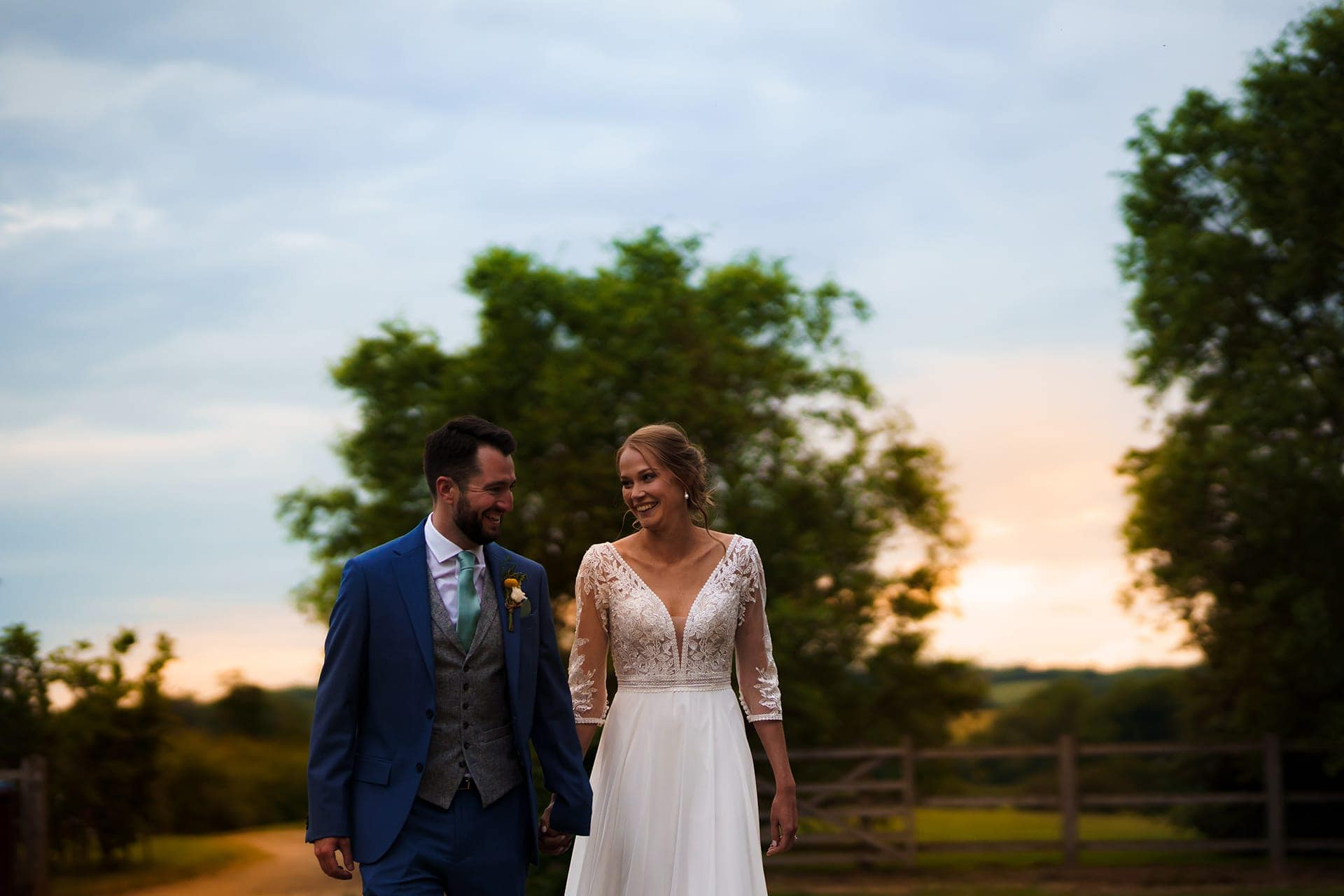 A bride and Groom enjoy their wedding at Dodford Manor during sunset